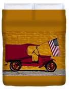 Red Truck Against Yellow Wall Duvet Cover