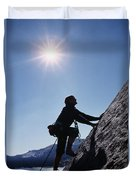 Rock Climber On Polly Dome Above Lake Duvet Cover
