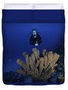 Scuba Diver Swims Underwater Amongst Duvet Cover