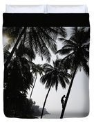 Silhouetted Man Climbing A Palm Tree To Duvet Cover