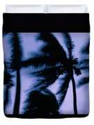 Silhouetted Palm Trees Blow In The Wind Duvet Cover