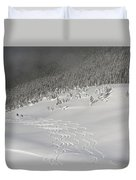 Skiers At The Base Of A Mountain Duvet Cover