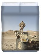 Soldier Climbs A Damaged Husky Tactical Duvet Cover by Stocktrek Images