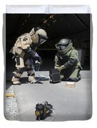 Soldiers Dressed In Bomb Suits Examine Duvet Cover