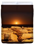 The Moon Rising Behind Rocks Lit Duvet Cover