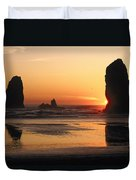 The Sun Sets Over The Sea Stacks Duvet Cover