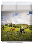 Three Horses Grazing In Field Duvet Cover
