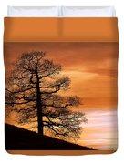 Tree Against A Sunset Sky Duvet Cover