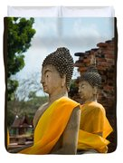 Two Buddha Statues Wrapped In An Orange Scarf  Duvet Cover