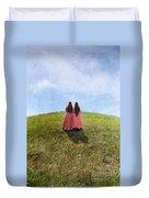 Two Girls In Vintage Dresses Walking Up Grassy Hill Duvet Cover