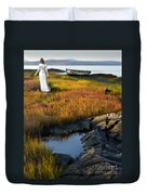 Woman By Boat On Grassy Shore Duvet Cover