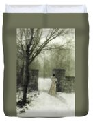 Young Lady By Stone Pillar In Snow Duvet Cover