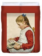 A Girl Looking At A Book Duvet Cover