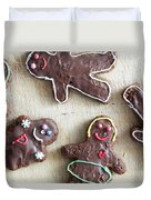 Handmade Decorated Gingerbread People Lying On Wooden Table Duvet Cover