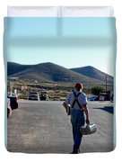 Man Walking With Newspapers Duvet Cover