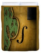 Old Violin Against Green Wall Duvet Cover