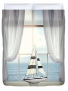 Toy Boat In Window Duvet Cover
