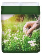 Woman Picking Up Flowers On A Meadow, Hand Close-up. Vintage Light Duvet Cover