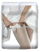 Woman Putting On White Stockings Duvet Cover