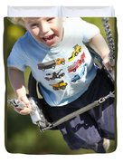 Young Boy Smiling Swinging In A Swing Duvet Cover