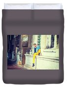 Young Man Relaxing On Street Duvet Cover