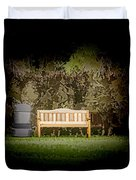 A Trash Can And Wooden Benches In A Small Grassy Area Duvet Cover