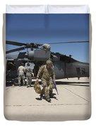 Pararescuemen Walks Away From A Hh-60g Duvet Cover