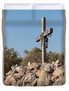 Rosary Hanging On A Small Wooden Cross On A Stone Wall Duvet Cover