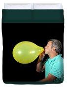 Man Inflating Balloon Duvet Cover