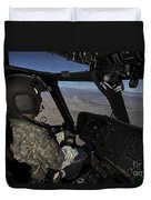 Pilot Operating The Cockpit Of A Uh-60 Duvet Cover