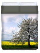 A Blooming Tree In A Rapeseed Field Duvet Cover