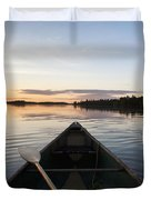 A Boat And Paddle On A Tranquil Lake Duvet Cover