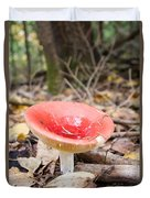 A Bright Red Mushroom Blooms Duvet Cover