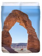 A Couple Kissing Under Delicate Arch In  The Arches National Par Duvet Cover