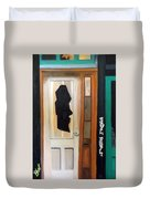 A Face In The Door Duvet Cover