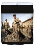 A Group Of Dog-handlers Conduct Duvet Cover by Stocktrek Images