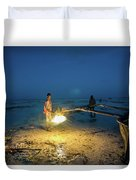 A Local Fisherman Uses Flame To Repair His Boat At Sunset Duvet Cover