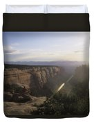 A Man Admires The Sunset From A Canyon Duvet Cover