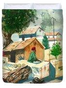 A Man Sitting Near A Tropical Village House Duvet Cover