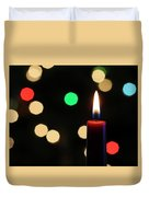 A Red Christmas Candle With Blurred Lights Duvet Cover