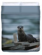 A River Otter Perched On Planks Of Wood Duvet Cover