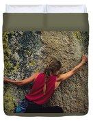 A Rock Climber On A Boulder Duvet Cover
