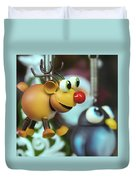 A Rudolph The Red Nosed Reindeer Ornament With A Penguin Duvet Cover