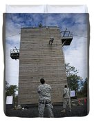 A U.s. Soldier Rappels Down A 40-foot Duvet Cover