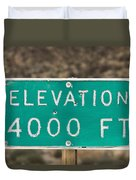 A Weathered Elevation Sign On Highway Duvet Cover