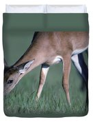 A White-tail Deer Munches On Some Green Duvet Cover