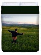 A Young Boy Runs Through A Field Duvet Cover
