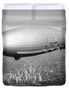 Airship Flying Over New York City Duvet Cover