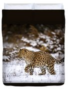 Amur Leopard Walks In A Snowy Forest Duvet Cover