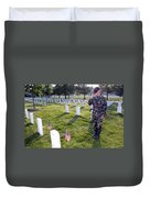 An Airman Renders Honors After Placing Duvet Cover by Stocktrek Images